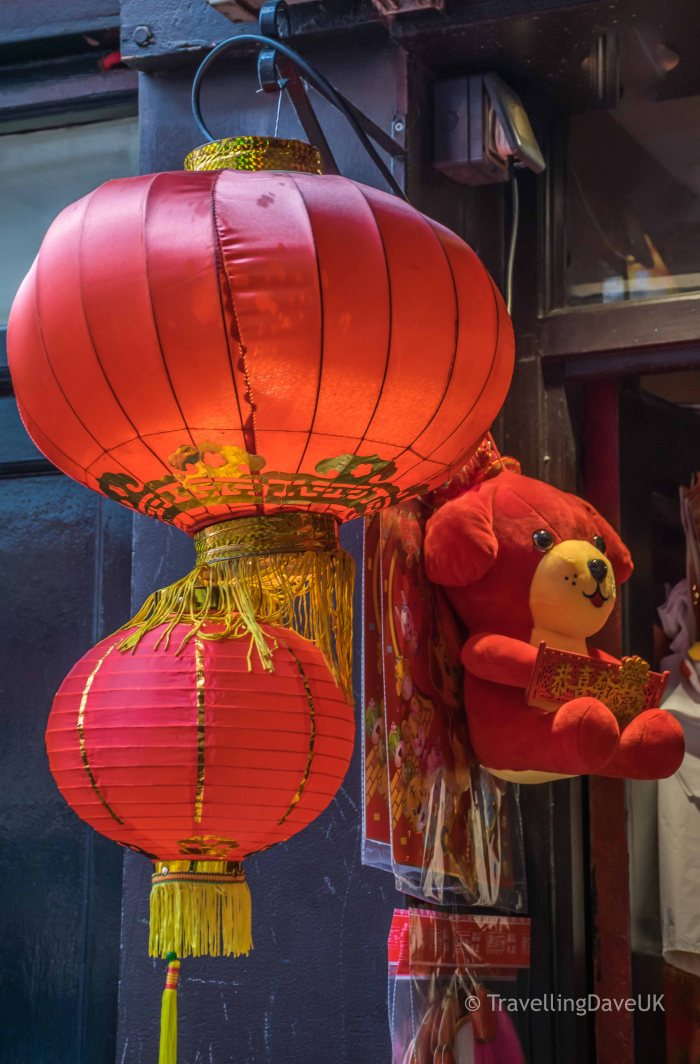 Red lanterns and a red toy dog in Chinatown