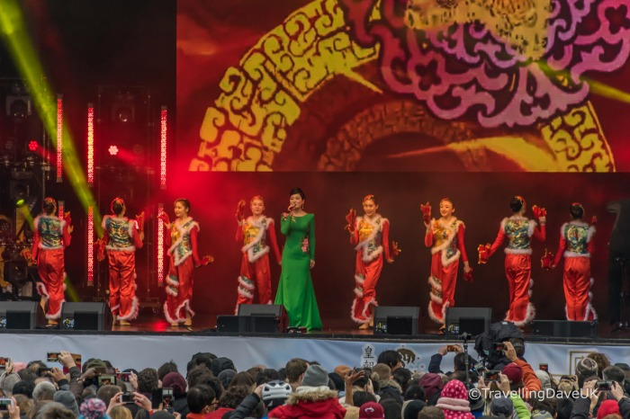 Colourful dressed singers on stage for Chinese New Year
