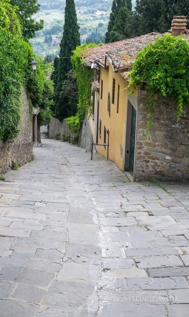 View of a steep street in the town of Fiesole in Italy
