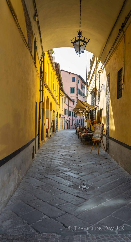 View of a colourful narrow street in Lucca in Italy