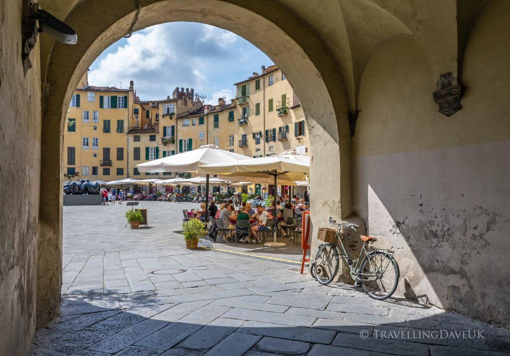 View of one of the archway entrances to Piazza Anfiteatro in Lucca in Italy