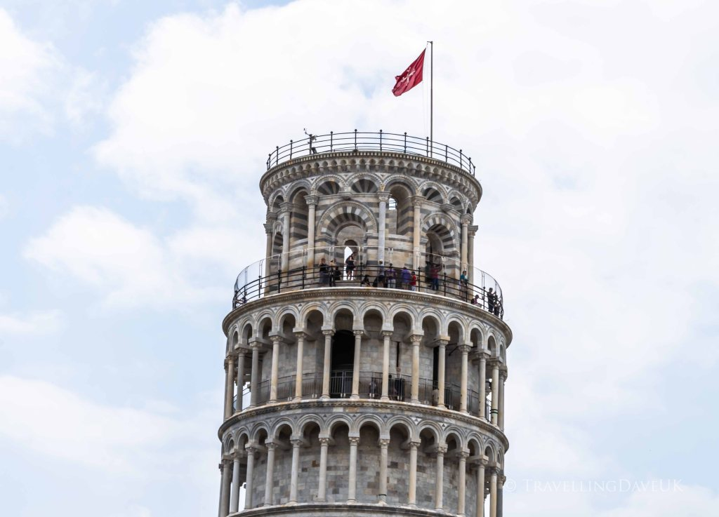 People on top of the Leaning Tower of Pisa in Italy