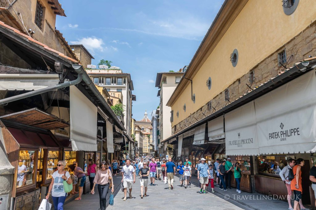 View of people and shops on Ponte Vecchio in Florence in Italy