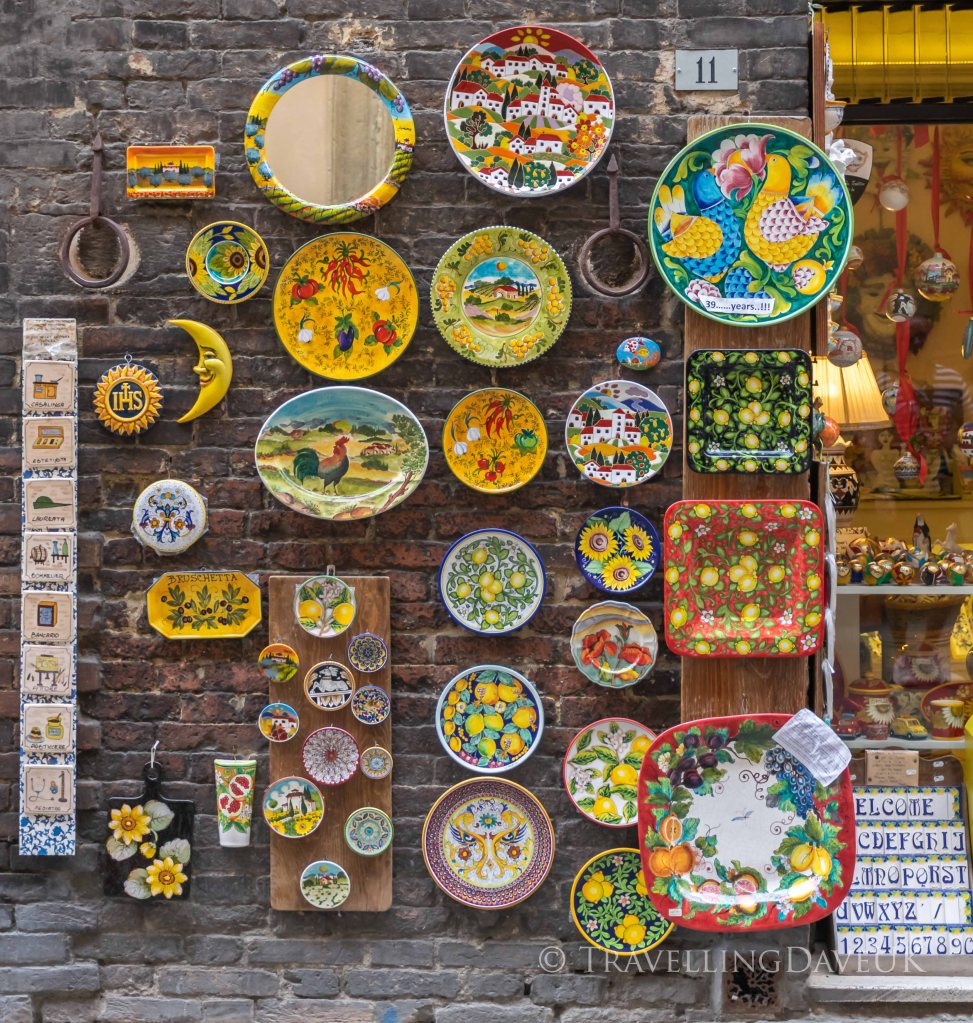 View of a colourful display outside a ceramics shop in Siena in Italy