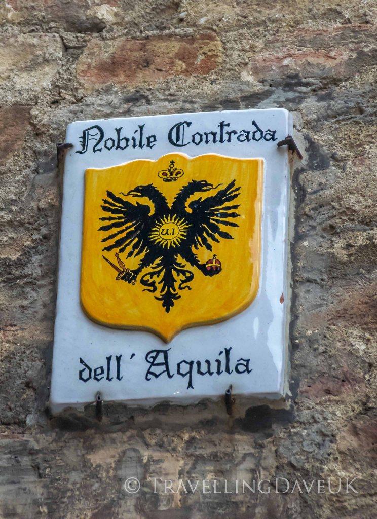 Siena contrada Aquila street sign
