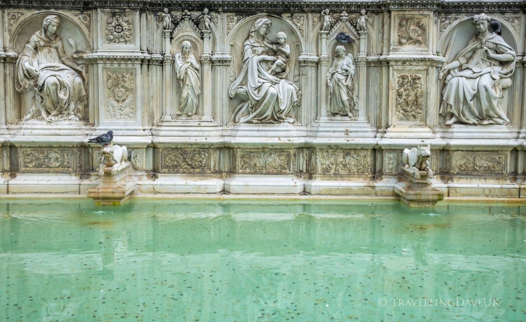 View of sculptures on the Fonte Gaia in the town of Siena in Italy